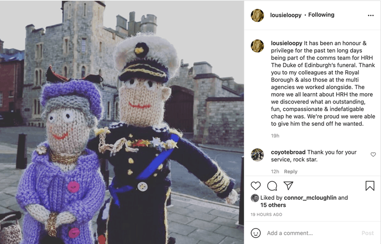 Screenshot of an Instagram post depicting two knitted dolls of the Queen and Prince Phillip outside Windsor Castle.